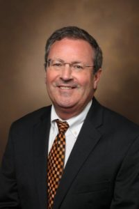 A head-and-shoulders professional photo of Rick W. Wright, MD.